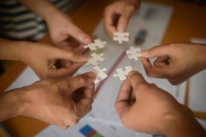 Hands holding jigsaw puzzles photo