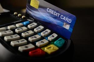 Credit card being swiped to pay for goods and services