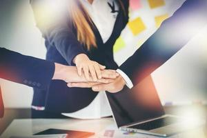 Business team joins hands together