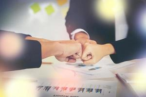 Business people showing fist bump after meeting partnership photo