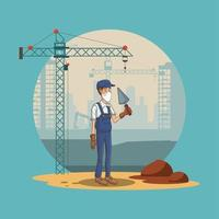 construction worker with spade using face mask for covid19 vector