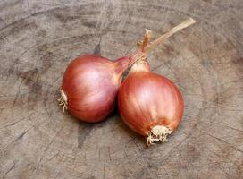 Two shallots on old wood
