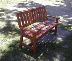 Park bench in grass photo