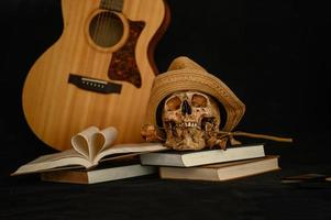 Still life with a heart-shaped book and a skull with dry flowers photo