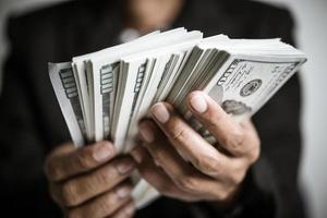 Hands of businesswoman holding money photo