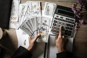 Business person calculates financial growth and investment photo