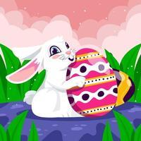 conejo sostiene un huevo de pascua vector