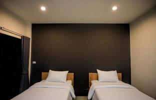 Twin bed hotel room in a hotel resort photo