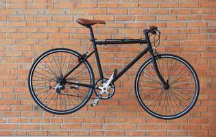 Vintage bicycle against a brick wall