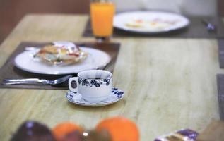A hot teacup or coffee cup on the dinner table
