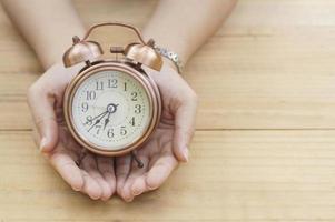 Alarm clock in hand photo
