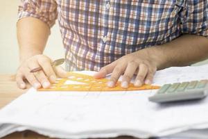 Engineer drawing and sketching photo