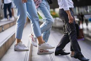 People walking on stairs in a city photo