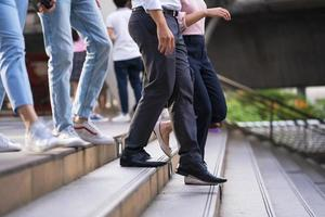 Many people walking on stairs photo