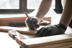 Carpenter using wood working tools photo