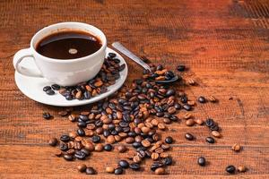 Cup of coffee and beans photo