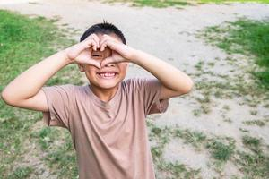 Boy making a heart with hands photo