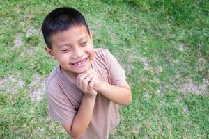 Boy playing outside photo