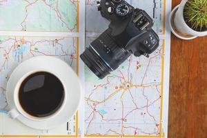 Camera and coffee on a map