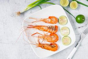 Top view of shrimp and limes photo