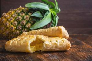 Pineapple pie on a wooden background