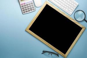 Blank chalk board on desk top