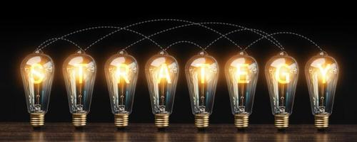 Lightbulbs with the word strategy photo
