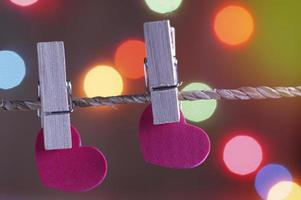 Two paper hearts with blur bokeh background photo
