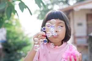 Cue young girl blow bubbles photo