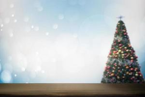 Top view of a wood table with soft blur abstract Christmas background photo