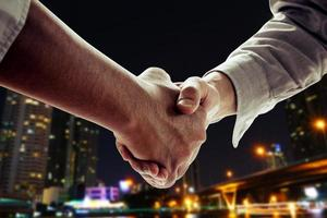 Two business people shaking hands photo