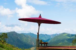 Wooden umbrella on balcony in Thailand photo