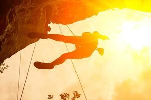 Silhouette of mountain climber at Riley beach, Krabi, Thailand photo