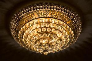 Close up of a beautiful crystal chandelier photo