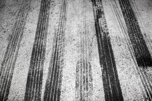 Black tire tracks on a road photo