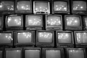 Wall of old vintage tube televisions photo