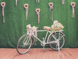 Old bicycle with flower decor photo