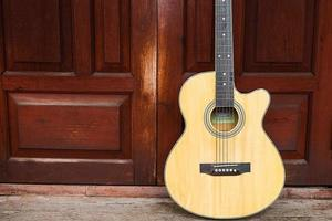 Acoustic guitar on wooden background photo