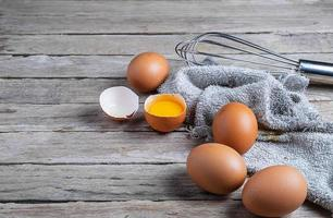 Eggs on a wooden table photo