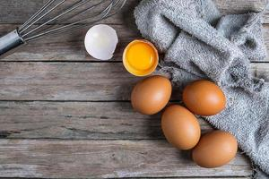 Top view of eggs on a wooden table photo