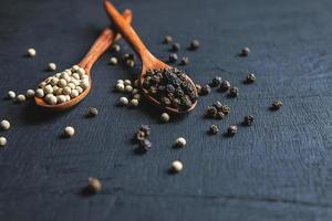 Peppercorns in spoons