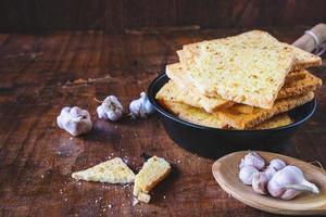 Crispy garlic bread on a plate photo
