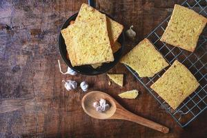 Garlic bread with garlic cloves photo