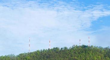 Telecommunications towers in the forest photo