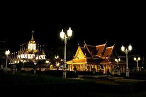 Temple and palace at night in Thailand photo
