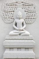 Stone carving of Buddha in Thailand photo
