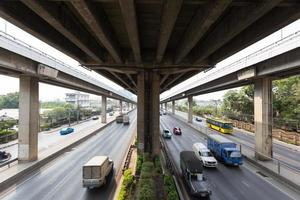 Car traffic under the bridge in Bangkok