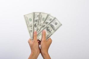 Woman's hand with money isolated on white background photo