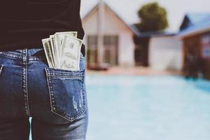 Woman with money in her back pocket photo