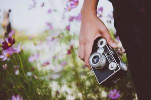 Close-up of hipster woman with vintage camera